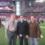 BMSS CEO Jon Radow, President Art Radow, and Director of New Builds Rich Brock on the field at a Cardinals game.
